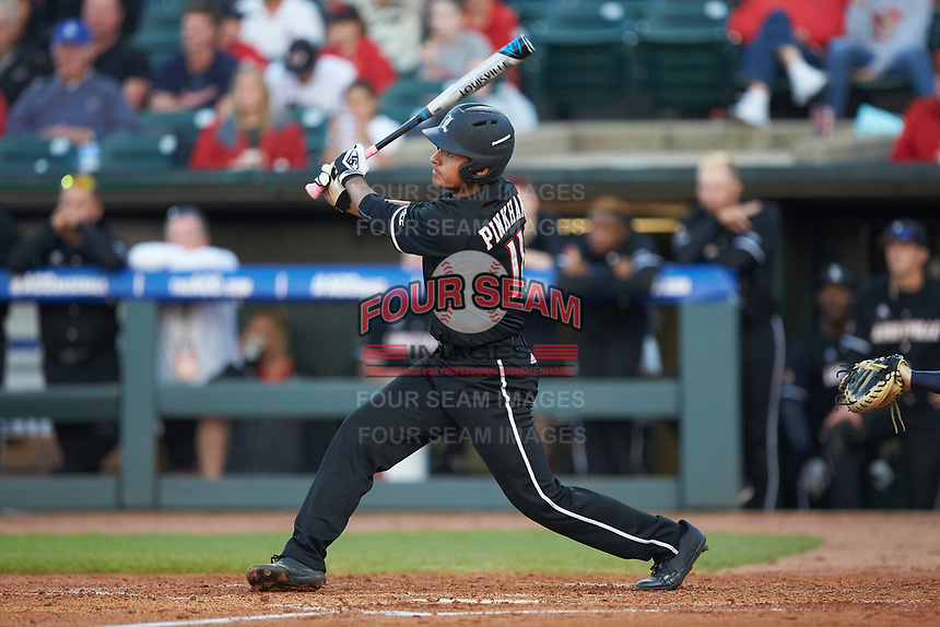 Zeke Pinkham (11) of the Louisville Cardinals follows through on his swing against the Notre Dame Fighting Irish in Game Eight of the 2017 ACC Baseball Championship at Louisville Slugger Field on May 25, 2017 in Louisville, Kentucky. The Cardinals defeated the Fighting Irish 10-3. (Brian Westerholt/Four Seam Images)