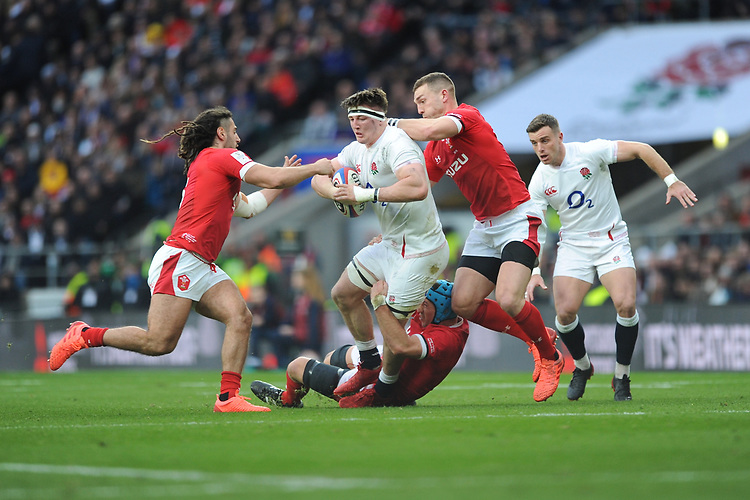 Tom Curry of England is tackled by Justin Tipuric, George North and Josh Navidi of Wales during the Guinness Six Nations match between England and Wales at Twickenham Stadium on Saturday 7th March 2020 (Photo by Rob Munro/Stewart Communications)