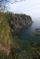 A view of Lake Superior and the rocky eastern shoreline of Presque Isle Park in Marquette, Michigan.