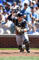 Milwaukee Brewers catcher Jonathan Lucroy (20) retrieves a pitch in the dirt during a game against the Chicago Cubs on August 14, 2014 at Wrigley Field in Chicago, Illinois.  Milwaukee defeated Chicago 6-2.  (Mike Janes/Four Seam Images)