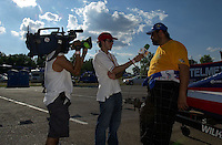 Carlos Kuri is interviewed for TV..St.Louis Grand Prix, St.Louis,MO,USA 19 Aug.2001.Copyright©F.Peirce Williams 2001..F. Peirce Williams .photography.P.O.Box 455 Eaton, OH 45320.p: 317.358.7326  e: fpwp@mac.com.