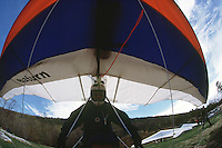 AIR SPORTS<br /> Hang Glider Ready For Take Off<br /> A hang glider is a triangular shaped airfoil. To launch, the pilot must run downhill to get air moving across the wing generating lift. Once aloft, gravity pulls the glider down and forward while thermals maintain lift.