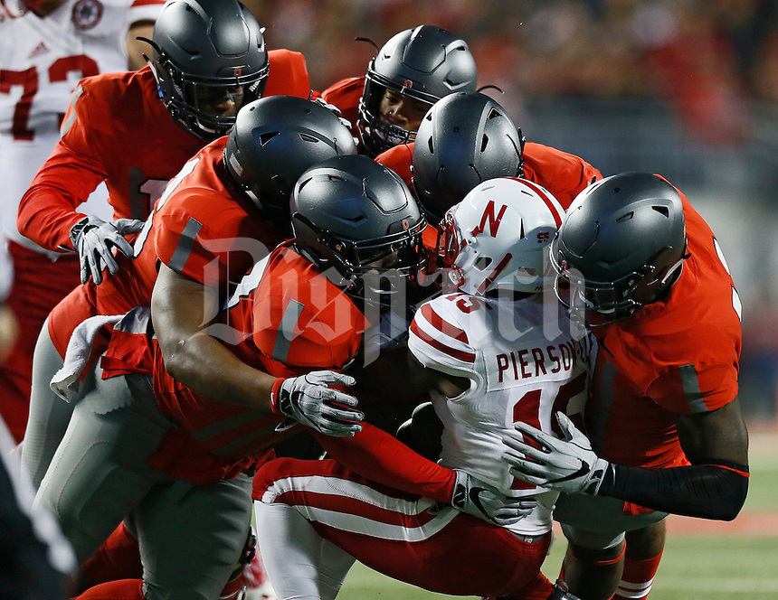 Ohio State Buckeyes defenders gang tackle Nebraska Cornhuskers wide receiver De'Mornay Pierson-El (15) during the second quarter of the NCAA football game at Ohio Stadium in Columbus on Nov. 5, 2016. (Adam Cairns / The Columbus Dispatch)