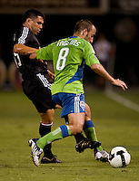 Peter Vagenas, Jaime Moreno. The Seattle Sounders defeated DC United, 2-1, to win the 2009 Lamr Hunt U.S. Open Cup at RFK Stadium in Washington, DC.