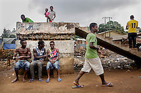 A group of young men inthe Kroo Bay shanty town, an area of extremely poor hygiene where only a few houses have running water and toilets.