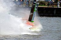 Frame 1, flip 1: Carlos Mendana (#27) barrel rolls in turn 1 during heat 3. Brother Jose Mendana, Jr. (#21) races past as Carlos boat rolls upright.   (Formula 1/F1/Champ class)