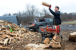WATERTOWN CT. - 27 December 2019-1227SV01-Jim Paige of Evergreen Lawn and Landscaping splits and piles wood for sale on Main Street in Watertown Friday. With the colder weather on it way they sell between 15 and 20 cords of wood a week.<br /> Steven Valenti Republican-American