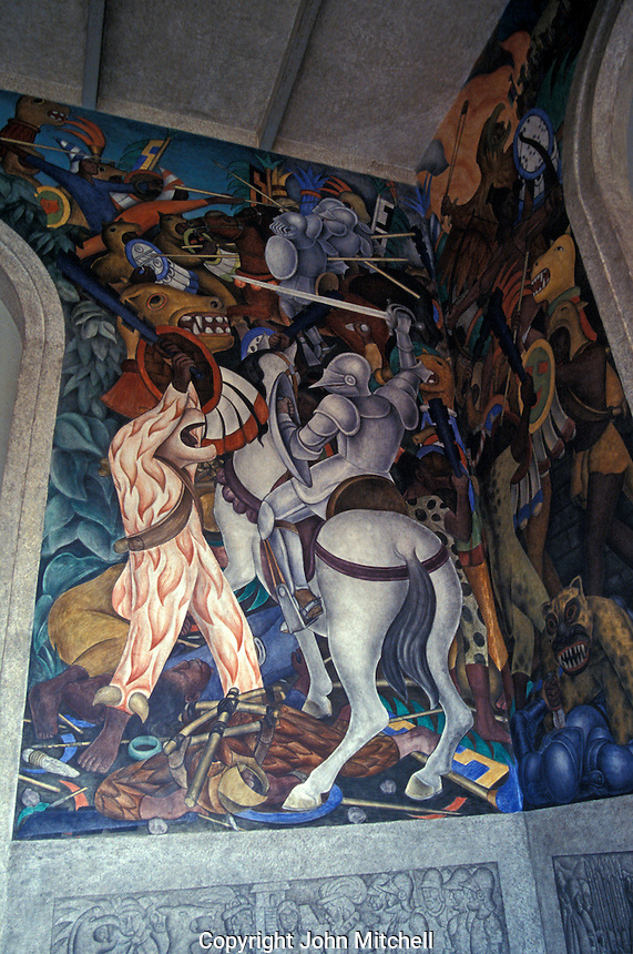 A panel of the mural by Diego Rivera  in the Palacio de Cortes in downtown Cuernavaca, Morelos, Mexico. This mural was painted in the 1920's. It shows the history of Mexico from the Spanish Conquest until the 1910 revolution.  Cortes' Palace now houses the Museo Regional Cuauhnahuac and murals by Diego Rivera.