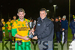PJ Murphy Gneeveguilla is presented the McElligott cup  after defeating Laune Rangers in the final in Currans on Friday night