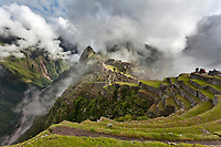 "Morning fog and clouds reveal Machu Picchu, the ancient ""lost city of the Incas"", 1400 CA, 2400 meters. Discovered by Hiram Bingham in 1911. One of Peru's top tourist destinations. Urubamba river in the distance."