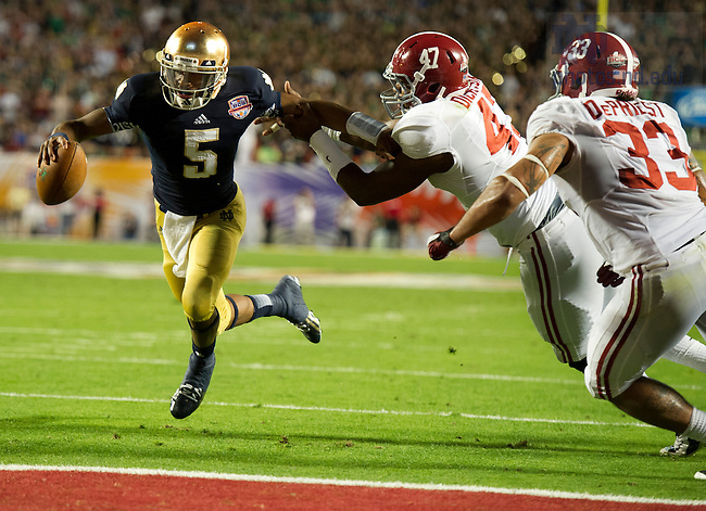 Jan. 7, 2013; Quarterback Everett Golson scores a touchdown past Alabama linebackers Xzavier Dickson and Trey DePriest during the second half of the 2013 BCS National Championship  in Miami, Florida. Alabama defeated Notre Dame 42 to 14. Photo by Barbara Johnston/University of Notre Dame