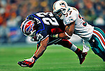 7 December 2008: Buffalo Bills' running back Marshawn Lynch is tackled by Miami Dolphins safety Yeremiah Bell short of first down yardage during the first regular season NFL game ever played in Canada. The Dolphins defeated the Bills 16-3 at the Rogers Centre in Toronto, Ontario. .