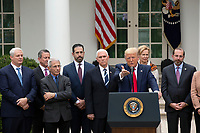 United States President Donald J. Trump, joined by United States Vice President Mike Pence, members of the Coronavirus Task Force, and Industry Executives, speaks during a news conference in the Rose Garden at the White House in Washington D.C., U.S., on Friday, March 13, 2020.  Trump announced that he will be declaring a national emergency in response to the Coronavirus.  Credit: Stefani Reynolds / CNP/AdMedia