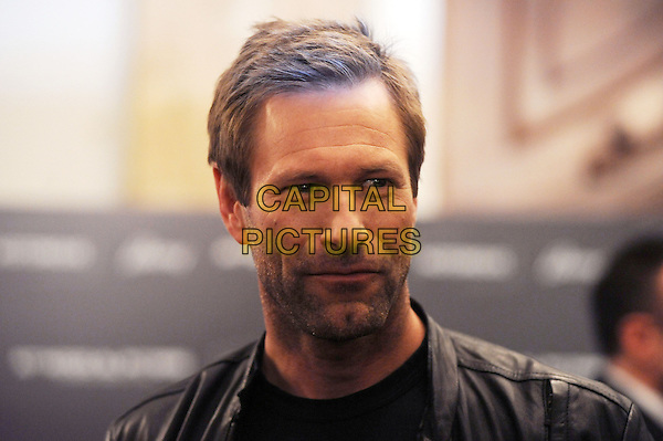 Aaron Eckhart.Attending a photocall for their new film, 'Olympus Has Fallen', Rome, Italy, .5th April, 2013..portrait headshot black leather jacket .CAP/IPP/GB.©Gioia Botteghi/IPP/Capital Pictures.
