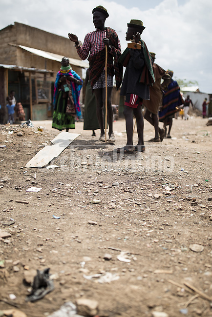 street scene in   Kakuma, Kenya.Kakuma refugee camp in North of Kenya. Kakuma is the site of a UNHCR refugee camp, established in 1991. The population of Kakuma town was 60,000 in 2014, having grown from around 8,000 in 1990. In 1991, the camp was established to host the 12,000 unaccompanied minors who had fled the war in Sudan and came walking from camps in Ethiopia.