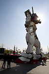 April 18, 2012, Tokyo, Japan - A 18-meter high full-scale model of the popular Gundam robot from the Japanese anime series created by Sunrise studios, is on display in front of Diver City Tokyo Plaza, a new shopping mall in Odaiba opening on April 19.