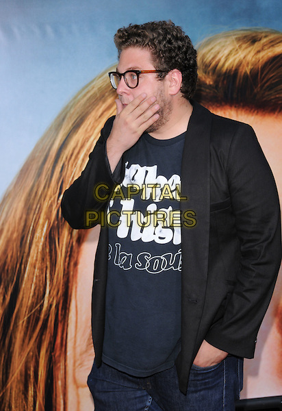 "JONAH HILL.The Columbia Pictures' World Premiere of ""Pineapple Express"" held at The Mann's Village Theatre in Westwood, California on .July 31st, 2008 .half length black suit jacket blue top glasses stubble beard facial hair high de la soul side view profile hand.CAP/DVS.©Debbie VanStory/Capital Pictures."