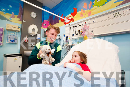 Donnacha Walsh (Kerry Footballer) with Eabha Mulvihill, Currow, pictured on Friday morning last, at the new updated Emergency Paediatric Department at University Hospital Kerry.