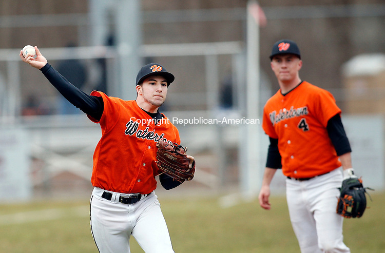 Naugatuck, CT- 08 April 2015-040815CM08- Watertown shortstop Alex Lopez makes the play to first during their NVL matchup against Naugatuck at Rotary Field on Wednesday.  Looking on is third baseman, Alex Burr.  Christopher Massa Republican-American