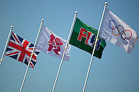 24.07.2012. London England.  The British and the Olympic flags seen in the Olympic park in London, Great Britain, 24 July 2012. The London 2012 Olympic Games will start on 27 July 2012.