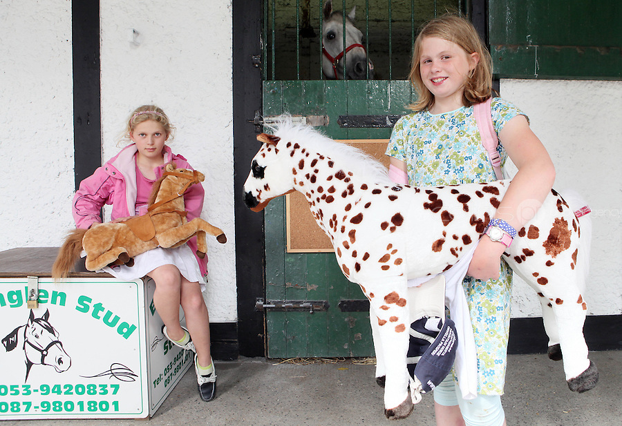 4/8/2010. Dorethy Wall 10 and Emma Hatton 10 from Fethard are pictured in the stables of the Failte Ireland RDS Horse Show. Picture James Horan/Collins Photos