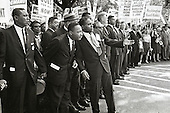 An unidentified man seems to be giving instructions to Dr. Martin Luther King, Jr. at the 1963 March on Washington for Jobs and Freedom in Washington, D.C. on August 28, 1963.<br /> Credit: Arnie Sachs / CNP