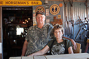 """KARNES COUNTY, TX - SEPTEMBER 25, 2013: Portrait of Lynn Buehring and her husband Shelby,  in Shelby's """"man cave"""" at their home near Karnes City, Texas. CREDIT: Lance Rosenfield/Prime"""