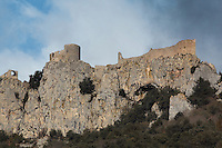 Peyrepertuse Castle or Chateau de Peyrepertuse, a ruined Cathar castle in Duilhac-sous-Peyrepertuse, Corbieres, Aude, France. This castle consists of a Lower Castle built by the Kings of Aragon in the 11th century and a High Castle built by Louis IX in the 13th century, joined by a huge staircase. Its name means pierced rock in Occitan and it has been associated with the Counts of Narbonne and Barcelona. It is one of the Five Sons of Carcassonne or Cinq fils de Carcassonne and is listed as a historic monument. Picture by Manuel Cohen