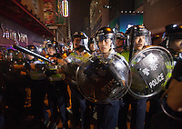Hong Kong police beat a hasty retreat after losing control of the Mong Kok area, and thus ceding it back to the protesters, who had only just lost it to the police hours earlier in a pre-dawn raid, Mong Kok, Kowloon, Hong Kong, China, 18 October 2014.