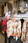 Alaska, Sitka..Shopping for furs..Photo copyright Lee Foster, 510/549-2202, lee@fostertravel.com, www.fostertravel.com.