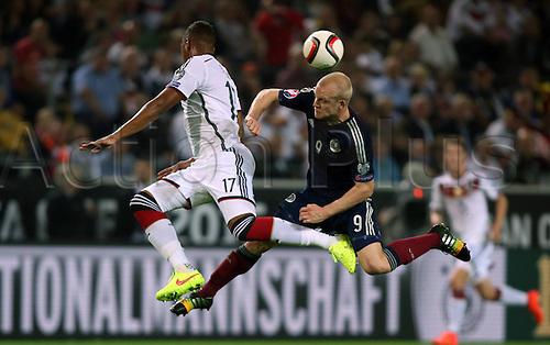 07.09.2014. Dortmund, Germany.   international match Germany Scotland  in Signal Iduna Park in Dortmund. Jerome Boateng challenges  Steven Naismith (Sco)
