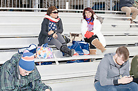 People sit on bleachers put up along the inaugural parade route outside the White House in Washington, D.C., on Jan. 19, 2017, the day before the inauguration of president-elect Donald Trump.