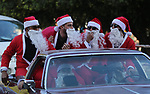 Palestinians dressed as Santa Claus ride a red car to welcome the new year, in the streets of Gaza City, New Year's Eve revellers on December 31, 2017. Photo by Ashraf Amra