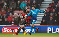 Hector Bellerin of Arsenal & Lewis Cook of AFC Bournemouth during the Premier League match between Bournemouth and Arsenal at the Goldsands Stadium, Bournemouth, England on 14 January 2018. Photo by Andy Rowland.