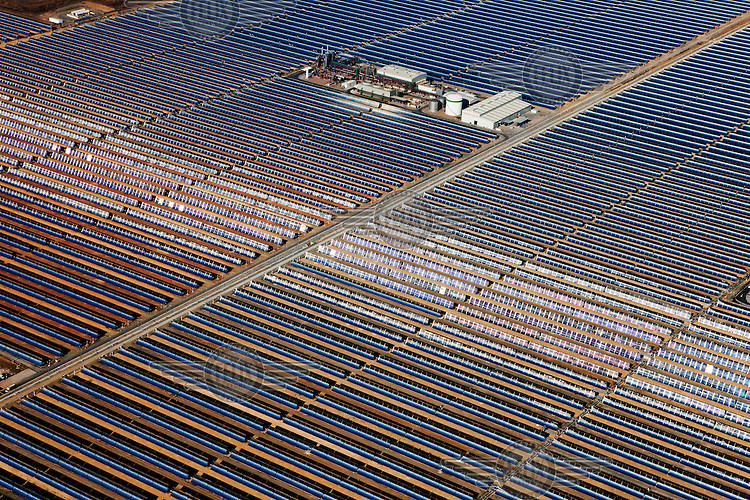 Fields of parabolic mirrors surround the Solnova 1, 3, and 4 concentrating solar power (CSP) projects. This is a parabolic trough solar thermal energy collector. They each produce 50 megawatss of electricity and are owned and operated by Abengoa Solar.