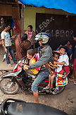 INDONESIA, Flores, a father and his three sons ride a motorbike at the Bajawa market in Bajawa