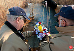 WATERBURY, CT-120714JS11- Dan Potter, left, and Cosimo &ldquo;Doc&rdquo; D&rsquo;Occhio, both members of the Waterbury Veterans Memorial Committee prepare to lower a boat filled with flowers into the Naugatuck River on Sunday to honor the spirit of the 2,403 men who died in the Pearl Harbor attack. The event, which took place on the Pearl Harbor Memorial Bridge on Freight Street in Waterbury, was just one of many local observances for Pearl Harbor Day.<br /> .Jim Shannon Republican-American