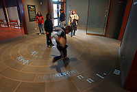 Visitors walk across the interactive bluestone floor inside the Stacy Smith Liss Gallery at the new Thomas Jefferson Visitors Center and Smith Education Center. When visitors step on words in the floor, phrases are projected at their feet then move across the floor eventually appearing on the wall as completed quotations. The new visitors center at Monticello opening April 15, 2009 in Charlottesville, VA. Photo/Andrew Shurtleff Display image Only: Monticello-the historical home of Thomas Jefferson located in Charlottesville, Va. Photo/Andrew Shurtleff