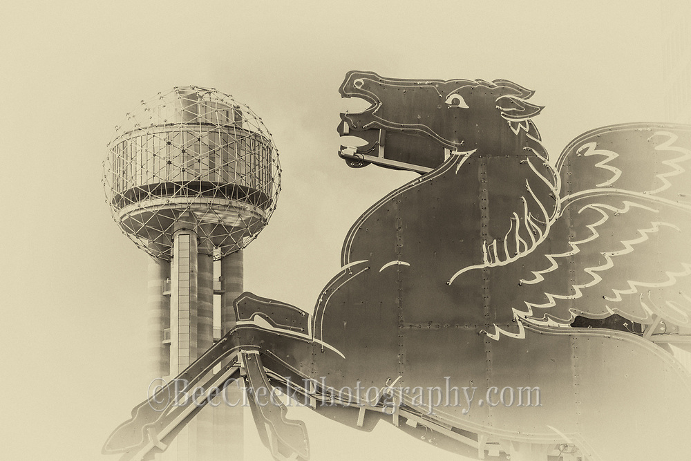 This Dallas vintage Pegasus show a close up with the Reunion Tower in the background as it appears to hoover over the city. The Pegasus and the Reunion Tower are both official lankmarks for the city of Dallas and a toursit destination of things to see. Many come downtown to see these two iconic structures.