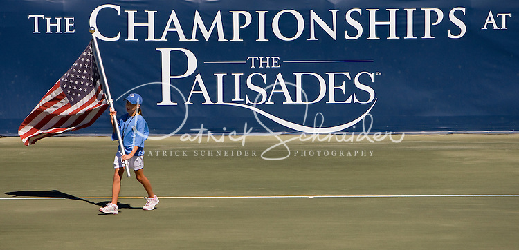 A young girl carries an American flag off the court during the Championships at the Palisades in Charlotte, NC.