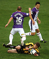 Phoenix' Jon McKain tackles Adriano Pellegrino during the A-League football match between Wellington Phoenix and Perth Glory at Westpac Stadium, Wellington, New Zealand on Sunday, 16 August 2009. Photo: Dave Lintott / lintottphoto.co.nz