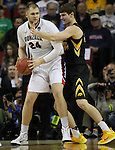 Gonzaga's Pryemek Karnowski tries to move around Iowa's Adam Woodbury (34) during the 2015 NCAA Division I Men's Basketball Championship's March 22, 2015 at the Key Arena in Seattle, Washington. #2 Gonzaga beat #7 Iowa 87-68 to advance to the Sweet 16.  ©2015 Jim Bryant Photo. ALL RIGHTS RESERVED.