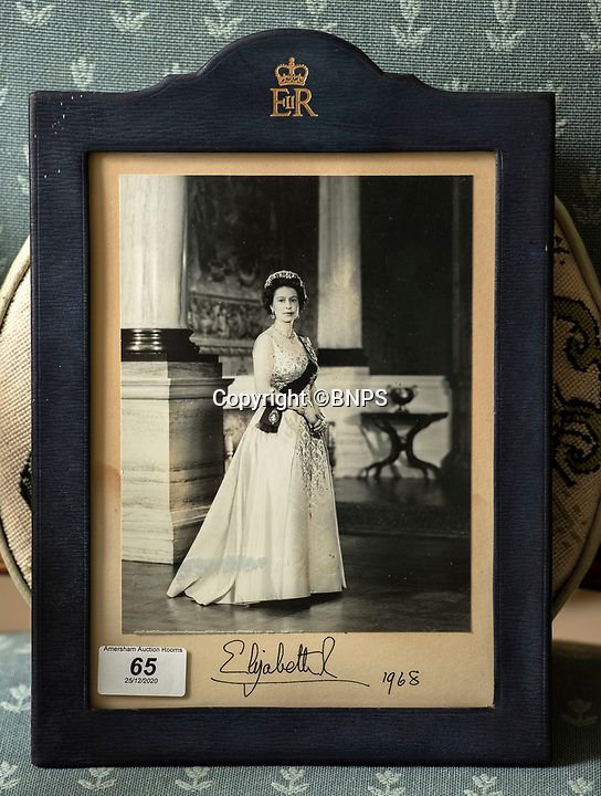BNPS.co.uk (01202 558833)<br /> Pic: PhilYeomans/BNPS<br /> <br /> Signed portrait from the Queen.<br /> <br /> A remarkable 'time warp' Royal archive amassed by the Queen's dressmaker has been found inside his old country home.<br /> <br /> The late Ian Thomas was a dress designer for members of the Royal Family, including Her Majesty, for over 30 years.<br /> <br /> As an apprentice he worked alongside the renowned fashion designer Norman Hartnell on creating the Queen's coronation dress in 1953.<br /> <br /> His archive includes embroidered samples of the gown worn by Elizabeth II for the historic ceremony in Westminster Abbey that was broadcast to millions.<br /> <br /> Mr Thomas also designed outfits for the Queen Mother and Princess Margaret.