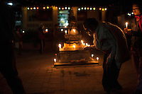 Nepali Buddhist people hold candle as they take part in a ritual activity in Bhaktapur, near Kathmandu, Nepal. May 04, 2015