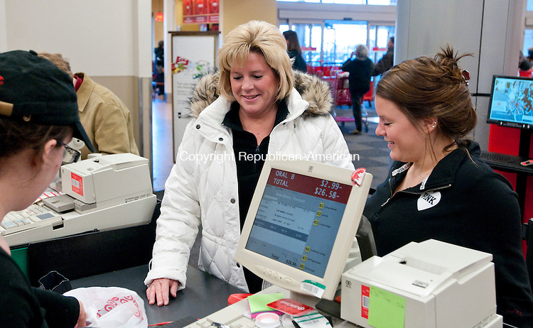 TORRINGTON,  CT, 26 DECEMBER  2011-122611JS01-Lisa Vinisko of Torrington, center, and her daughter Baylee Vinisko, 16, get help from Target Team Leader Nicole Johnson on Monday as they return some clothing items to the store. The day after Christmas is the most popular day to return items and is one of the busiest shopping days of the year as many customers also take advantage of post Christmas bargains. <br />  Jim Shannon Republican-American