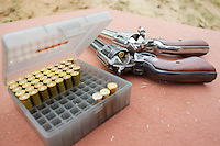 Ammo and gunds lie on a table before competition during the Cowboy Action Shooting European Championship in Dabas, Hungary on August 11, 2012. ATTILA VOLGYI