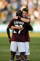 Drew Moor (3) of the Colorado Rapids celebrates with Luis Zapata (21) after defeating the Philadelphia Union. The Colorado Rapids defeated the Philadelphia Union 2-1 during a Major League Soccer (MLS) match at PPL Park in Chester, PA, on March 18, 2012.