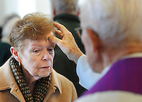 DOYLESTOWN, PA - FEBRUARY 18: Shirley White (L), of Doylestown, Pennsylvania receives ashes on her forehead from retired Monsignor James Mortimer for Ash Wednesday at Our Lady of Mt. Carmel Catholic Church February 18, 2015 in Doylestown, Pennsylvania. (Photo by William Thomas Cain/Cain Images)