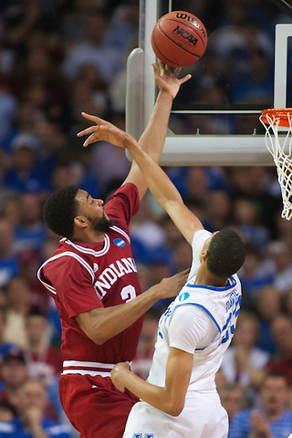 Indiana Hoosiers guard Maurice Creek shoots over Kentucky Wildcats forward Anthony Davis. Kentucky faced Indiana during the Sweet 16 round of the 2012 NCAA Tournament at the Georgia Dome in Atlanta,  March 23, 2012. Photo by