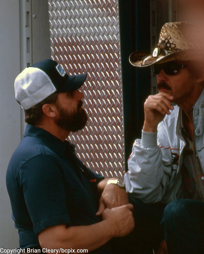 Brothers Richard Petty, right,  and Maurice petty talk in the garage area before the Southern 500 at Darlington Raceway in Darlington SC on September 1, 1985. (Photo by Brian Cleary/www.bcpix.com)